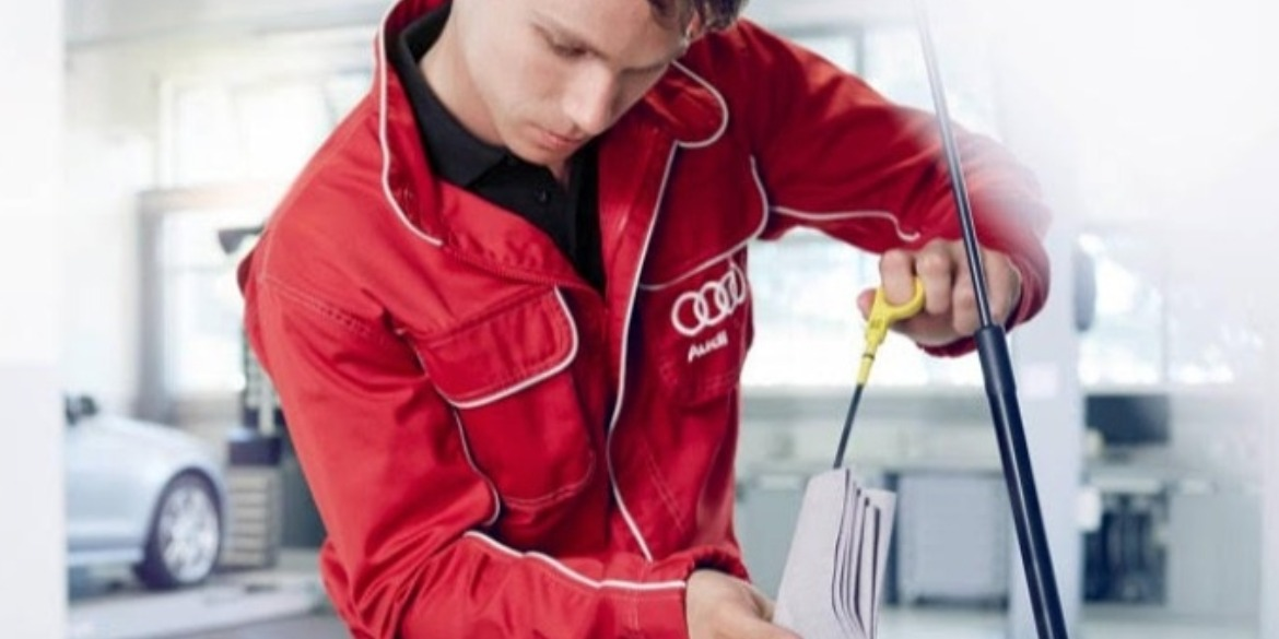 Audi technician checking the engine's oil levels